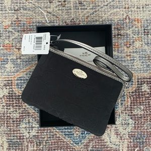 Black coach wristlet-brand new with tags & box